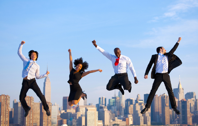Happy Successful Business People Celebrating And Jumping In New York City